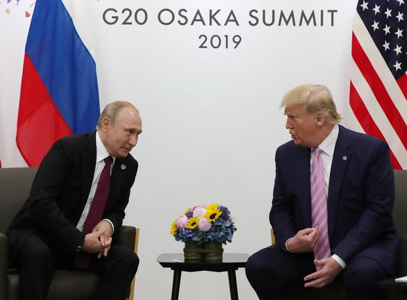 Ông Trump nói 'làm ơn đừng can thiệp bầu cử', ông Putin bật cười thích thú - Ảnh 3.