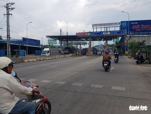 Đầu tư tuyến tránh Long Xuyên để xe không cần qua trạm thu phí T2 - Ảnh 1.