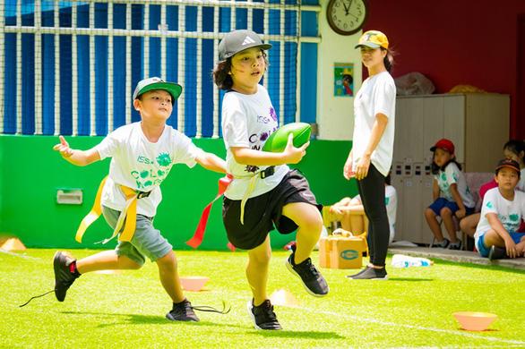 Thể thao giúp trẻ dễ hòa nhập và làm việc tập thể - Ảnh 1.