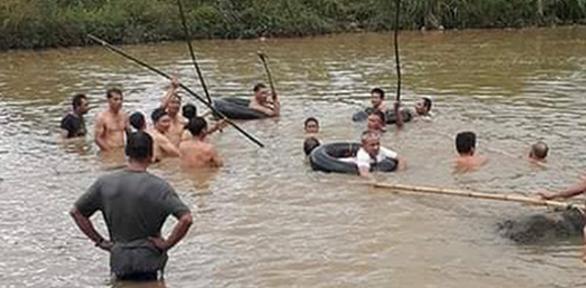 Rủ nhau tắm sông, hai anh em chết đuối thương tâm - Ảnh 1.