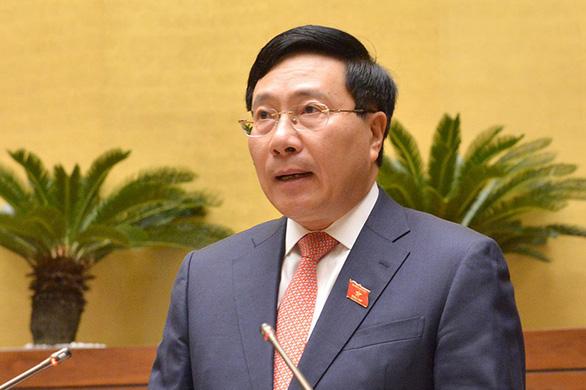 Thương chiến Mỹ - Trung có thể làm giảm 6.000 tỉ đồng GDP Việt Nam - Ảnh 1.