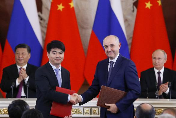 Bị Mỹ cấm, Huawei quay sang Nga ký thỏa thuận 5G - Ảnh 1.
