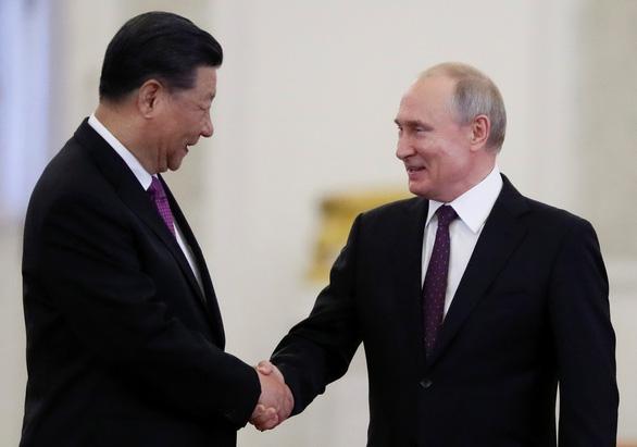 Mỹ đẩy Nga - Trung gần nhau hơn? - Ảnh 1.