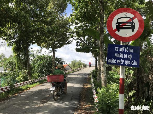 Cầu Tân Nghĩa thông xe, cho xe máy và người đi bộ qua cầu - Ảnh 1.