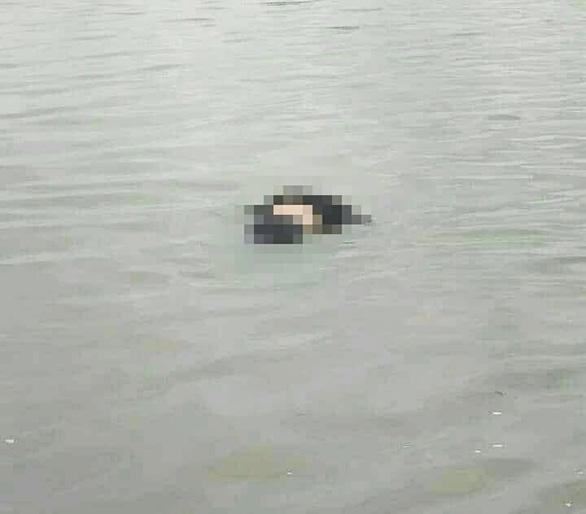 Phát hiện thi thể vợ chồng dạt vào bờ sau hai ngày mất tích trên biển - Ảnh 1.