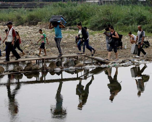 4 triệu người đã rời Venezuela vì khủng hoảng kinh tế, chính trị - Ảnh 1.