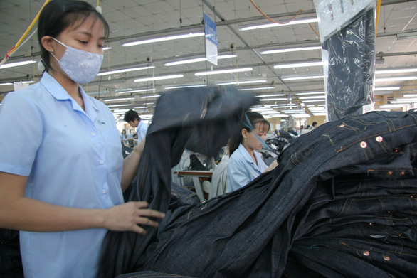 Xanh hóa ngành dệt may vẫn là thách thức - Ảnh 1.