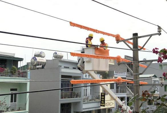 Vào đợt nắng nóng mới, điện lực miền Bắc kêu gọi sử dụng điện tiết kiệm - Ảnh 1.