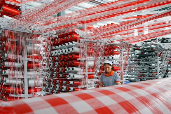 Vì sao kinh tế Trung Quốc tăng trưởng thấp nhất trong gần 3 thập kỷ? - Ảnh 1.