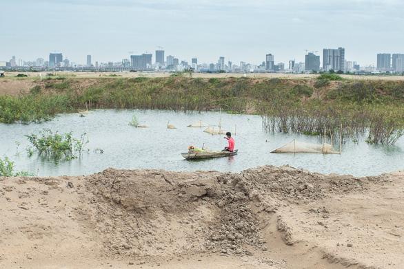 San lấp ao hồ để xây thành phố, Campuchia sẽ trả giá bằng ngập lụt? - Ảnh 1.