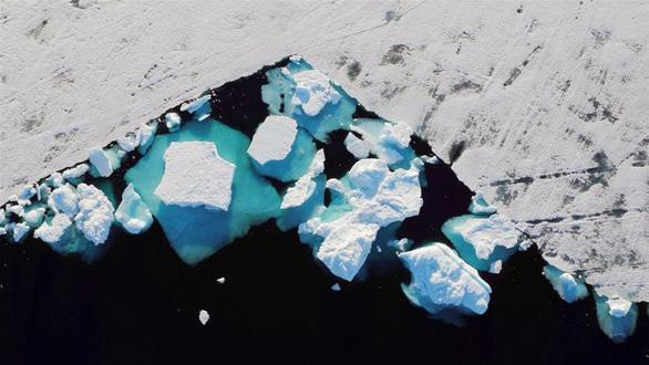 Nắng nóng kỷ lục lan tới Bắc Âu, đe dọa tan băng ở Bắc Cực - Ảnh 1.