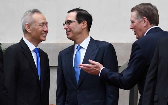 Mỹ - Trung đổi nơi đàm phán, mong cơ hội mới - Ảnh 1.