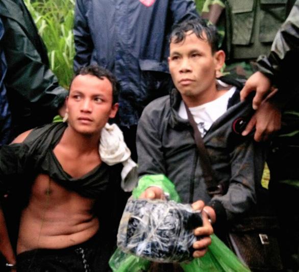 Bắt 2 người Lào vận chuyển 2kg ma túy đá tại ngã ba biên giới - Ảnh 1.