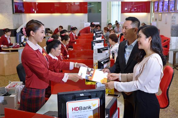 HDBank báo lãi 2.211 tỉ đồng, nợ xấu dưới 1% - Ảnh 1.