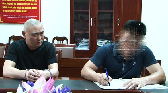 Bị truy nã ở Trung Quốc, dạt sang Việt Nam bị bắt trong khách sạn - Ảnh 1.