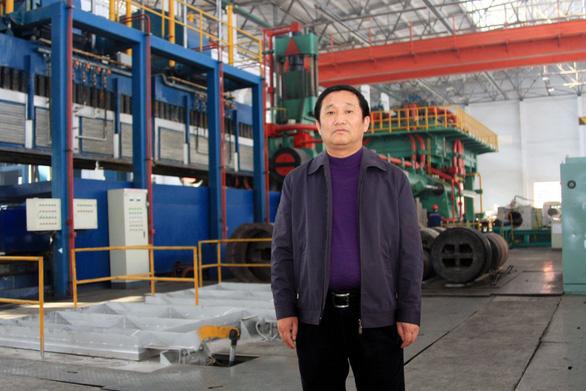 Mỹ buộc tội tỉ phú nhôm Trung Quốc trốn thuế gần 2 tỉ USD - Ảnh 1.