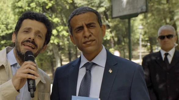 Bôi mặt đen để giống Obama, hãng hàng không Ý phải xin lỗi - Ảnh 1.