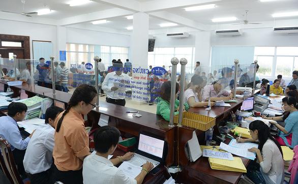 TP.HCM tạm dừng thu nhập tăng thêm: hụt hẫng và buồn - Ảnh 1.