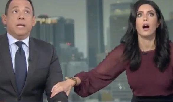 Video người dẫn chương trình chui xuống gầm bàn vì động đất ở California - Ảnh 3.
