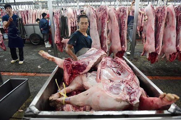 Cần có giải pháp ổn định giá thịt heo - Ảnh 2.
