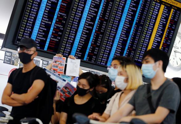 Sân bay quốc tế Hong Kong bị đình trệ nghiêm trọng - Ảnh 3.