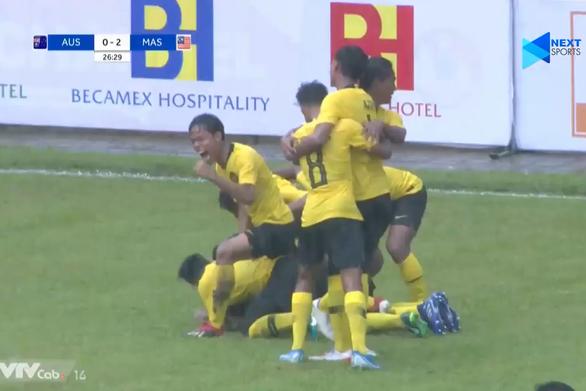 U18 Malaysia đè bẹp Úc 3-0, tiễn U18 Thái Lan về nước - Ảnh 1.
