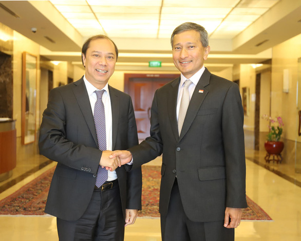 Việt Nam, Singapore ủng hộ giải quyết vấn đề Biển Đông dựa trên UNCLOS - Ảnh 1.