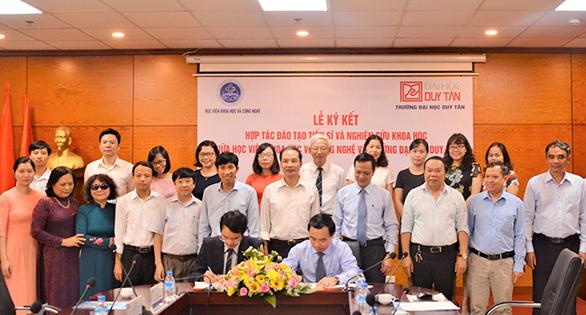 ĐH Duy Tân hợp tác với Học viện Khoa học & công nghệ đào tạo tiến sĩ - Ảnh 1.