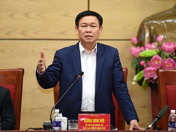Chính phủ 'sốt ruột' vì Hà Nội, TP.HCM có tiền mà không tiêu được - Ảnh 1.