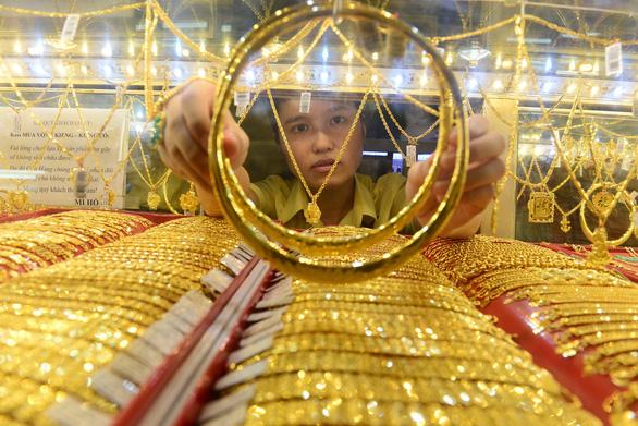 Giá vàng tăng gần 41 triệu đồng/lượng giữa căng thẳng Mỹ - Trung - Ảnh 1.