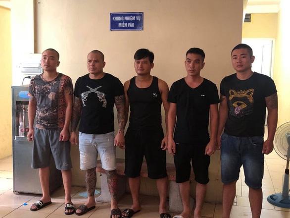 Khởi tố trùm đòi nợ thuê Quang Rambo và 4 đồng phạm - Ảnh 1.