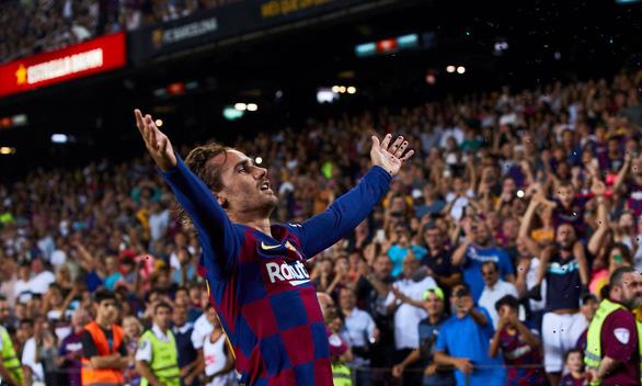 Griezmann lập cú đúp giúp Barca lội ngược dòng đá bại Real Betis - Ảnh 1.