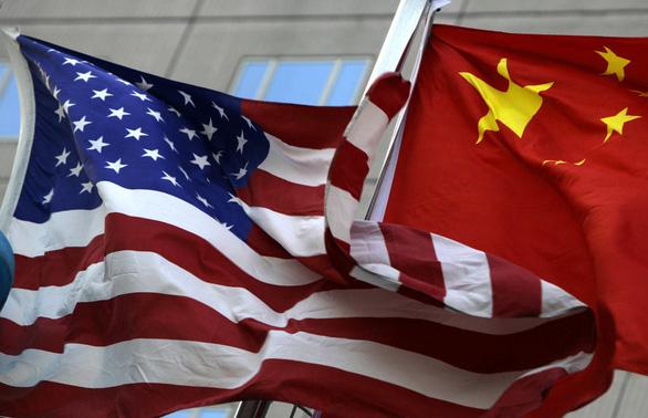 Chứng khoán suy giảm, tiền tệ chao đảo vì thương chiến Mỹ - Trung leo thang - Ảnh 1.