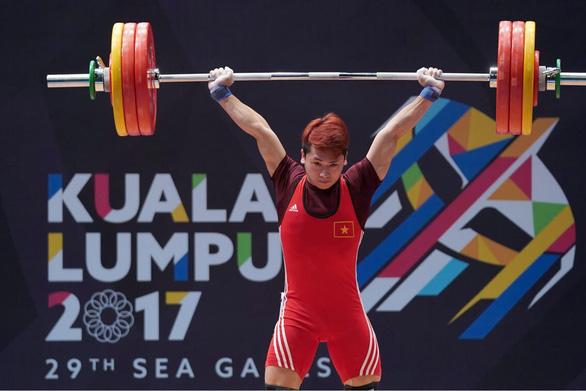 Dính doping, lực sĩ Trịnh Văn Vinh bị cấm thi đấu 4 năm, phạt 5.000 USD - Ảnh 1.