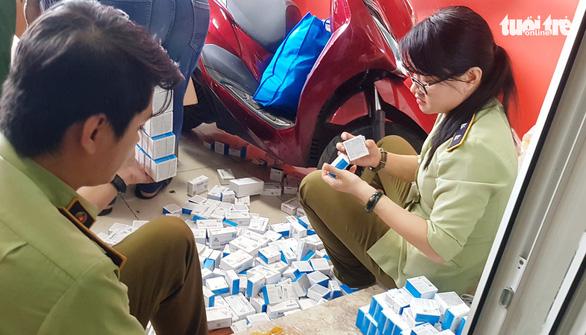 Phát hiện điểm chứa thuốc tân dược nhập lậu trị giá hàng tỉ đồng tại TP.HCM - Ảnh 2.
