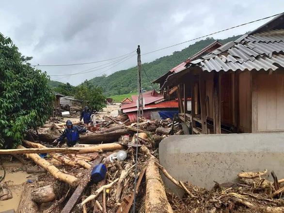 Một người chết, 13 người mất liên lạc do mưa bão số 3 - Ảnh 1.