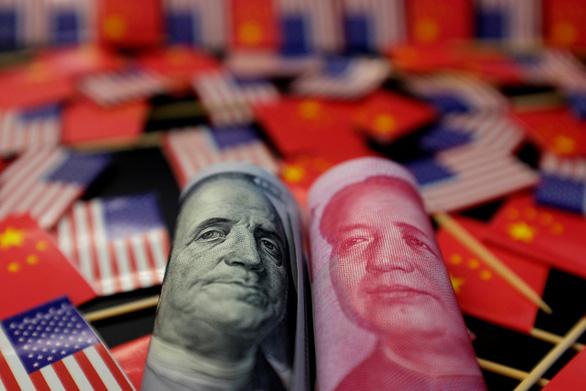 Mỹ bắn tín hiệu chiến tranh tiền tệ với Trung Quốc? - Ảnh 1.