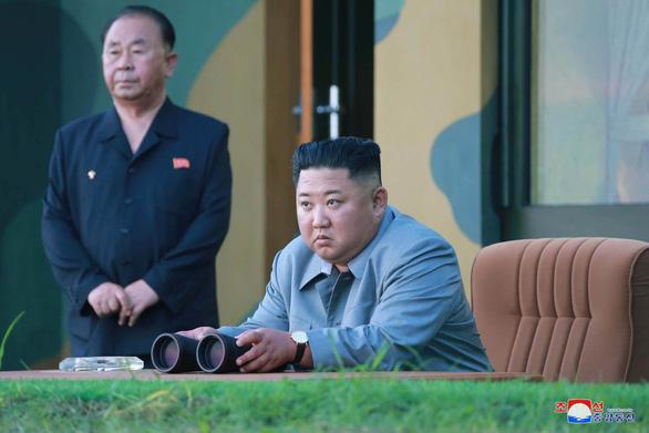 Ông Un nói bắn tên lửa để cảnh cáo Mỹ-Hàn - Ảnh 1.