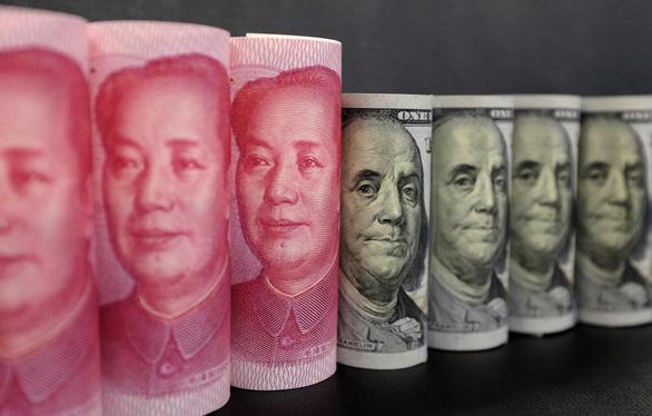 Trung Quốc lại điều chỉnh tỉ giá nhân dân tệ - Ảnh 1.