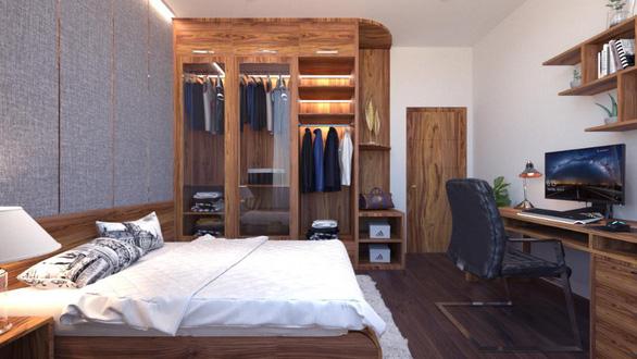 Căn hộ 3 phòng ngủ trở nên sang trọng, hiện đại hơn nhờ chất liệu gỗ tối màu - Ảnh 7.