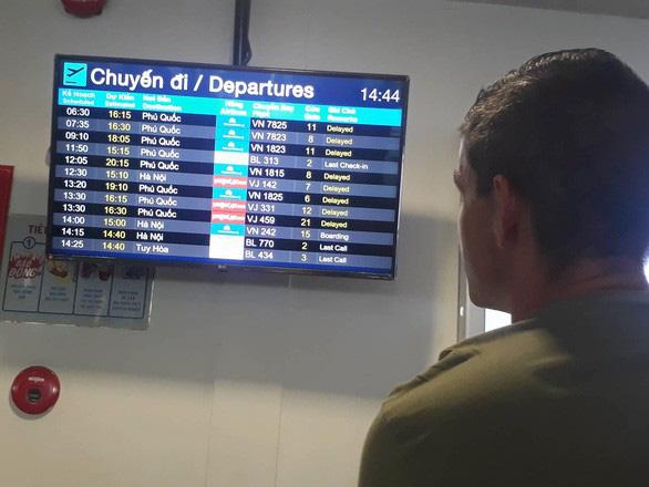 Hết ngập, sân bay Phú Quốc khai thác trở lại trong tối 9-8 - Ảnh 1.