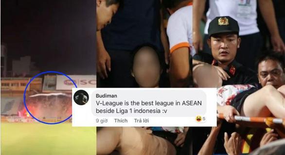 Bóng đá Việt Nam bị bôi đen sau vụ cổ động viên Nam Định ném pháo sáng - Ảnh 1.