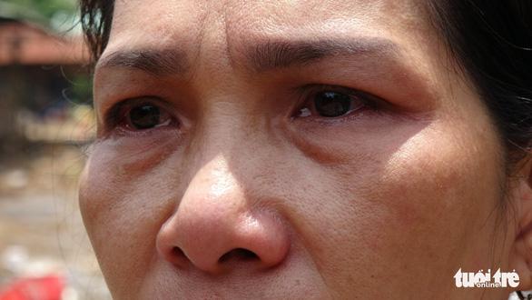 Tiểu thương bật khóc giữa tro tàn chợ Mộc Bài ở Bình Định - Ảnh 6.