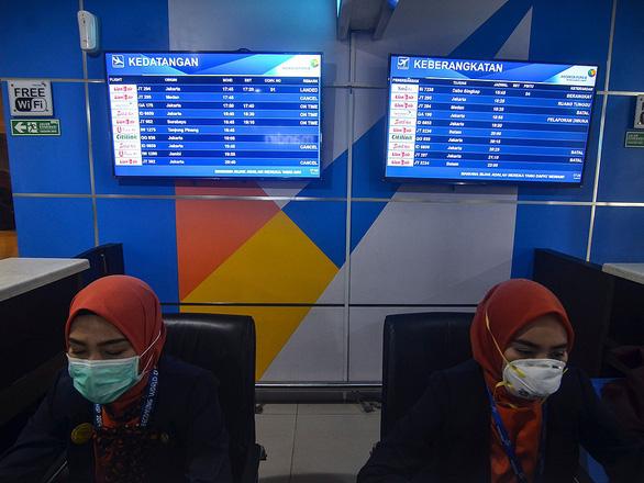 Khói bụi cháy rừng, Indonesia đóng cửa hàng loạt trường, mở thêm trạm y tế - Ảnh 2.