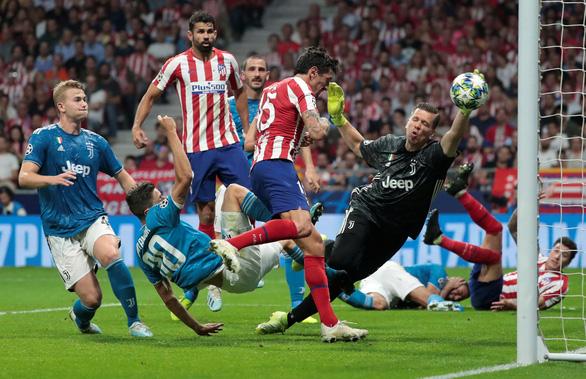 Ronaldo mờ nhạt, Juventus đánh rơi chiến thắng dù dẫn trước Atletico 2-0 - Ảnh 3.