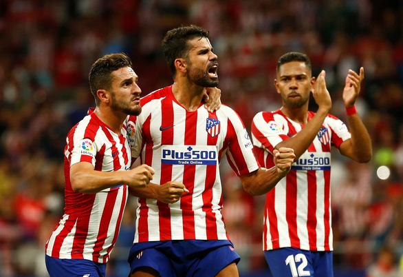 Ronaldo mới ghi bàn đầu tiên ở La Liga giúp Atletico Madrid lội ngược dòng ngoạn mục - Ảnh 3.