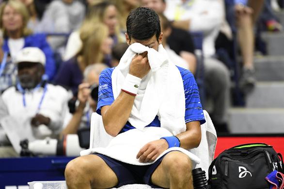 Djokovic bỏ cuộc vì chấn thương, Wawrinka vào tứ kết Mỹ mở rộng - Ảnh 2.