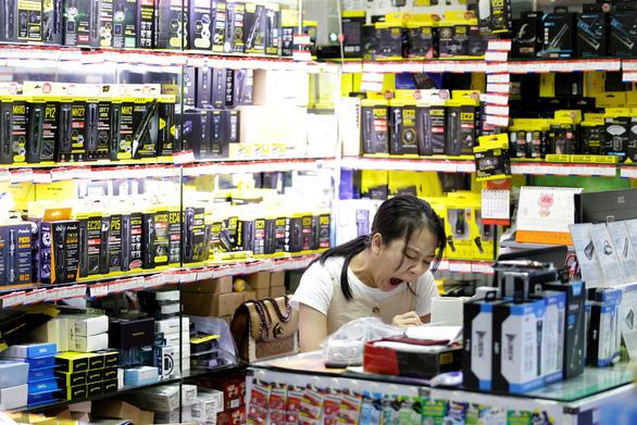 Trung Quốc kiện chuyện Mỹ áp thuế 550 tỉ USD hàng hóa ra WTO - Ảnh 1.
