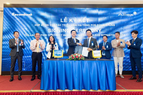 Sacombank và công ty cổ phần Alliex Việt Nam ký kết hợp tác triển khai hạ tầng POS dùng chung - Ảnh 1.