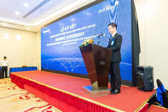 Sacombank và công ty cổ phần Alliex Việt Nam ký kết hợp tác triển khai hạ tầng POS dùng chung - Ảnh 2.